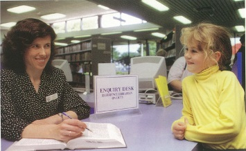 Reference librarian and young customer 1993