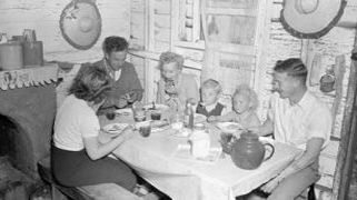 black and white photograph of family at table